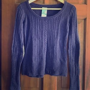 purple sweater with corduroy elbow patches